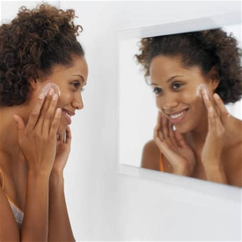 black woman looking in mirror diy treatment for eczema