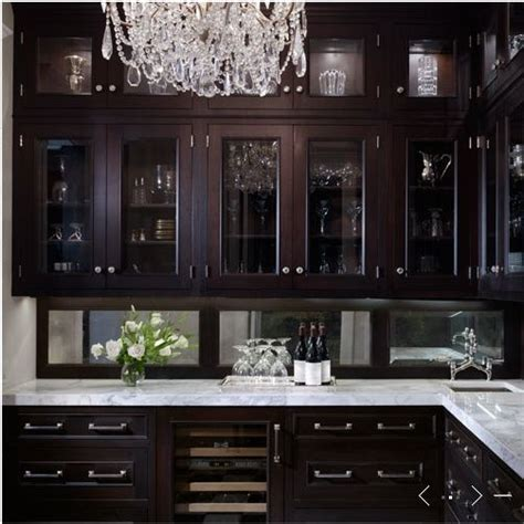 wood and glass kitchen cabinets 25 best ideas about dark wood kitchens on pinterest