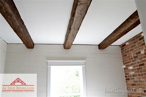 Diy Wood Beam Ceiling by Installing Faux Wood Beams In Our Master Bathroom