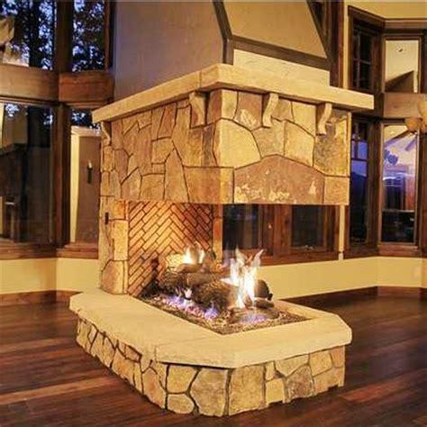 three sided fireplaces lite by masonry fireplace