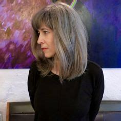 perm and blend gray with blonde transitioning from colored hair to silver grey hair