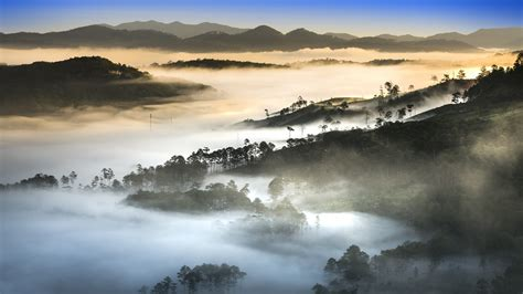 wallpaper sunset fog forest mountains  nature