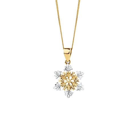 snowflake pendant in 10ct yellow white gold