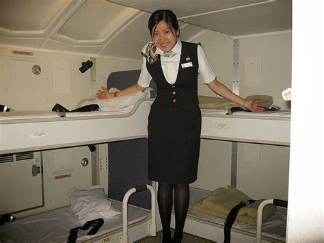 cabin attendants while jal cabin attendants not serving passengers world