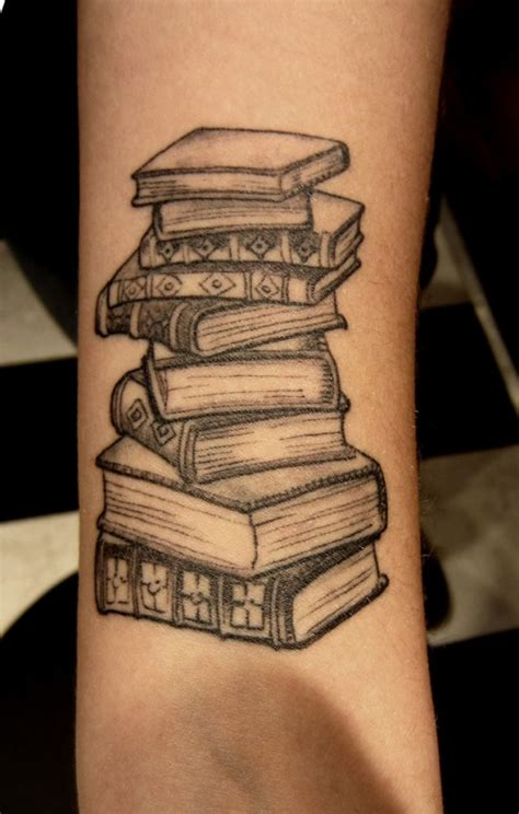 stack of books tattoo science source book on arm