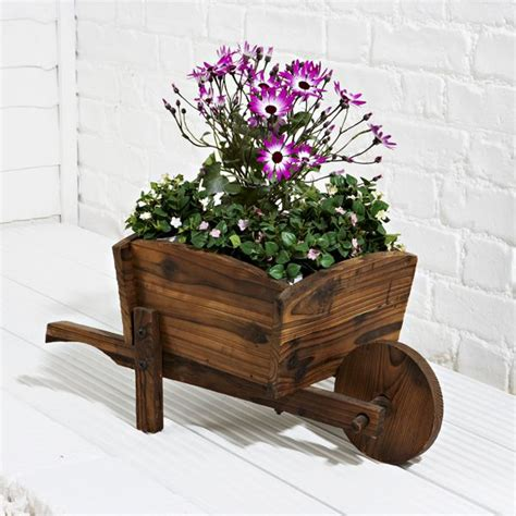 Wheelbarrow Planter by 1000 Ideas About Wheelbarrow Planter On