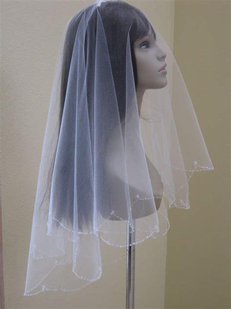 soft and sheer wedding veil beaded edge veil beaded