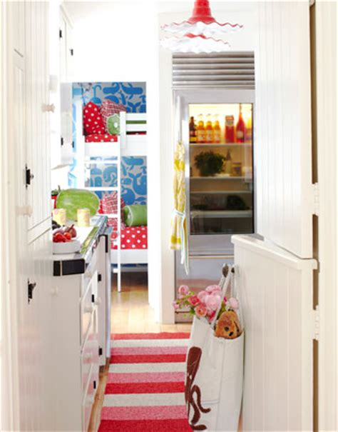 dutch door into kitchen in contrasting color and painted ceiling colorful beach house the decorologist