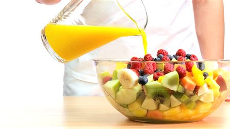 Modern Fruit Bowl by Fresh Orange Juice Being Poured Over A Bowl Of Healthy