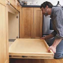 sliding drawers for kitchen cabinets install the shelf how to install a pull out kitchen shelf this old house