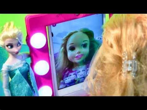 film elsa vs rapunzel disney frozen queen elsa doll gives princess rapunzel make