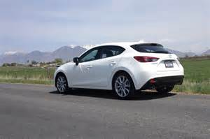 2014 mazda3 s grand touring hatchback rear three quarters