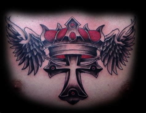 cross with wings tattoo on chest cross crown and wings across the chest by eli williams