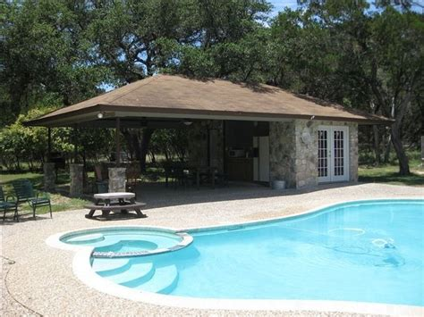 pool cabana with bathroom swimming pool with full bathroom shower and cabana kitchen