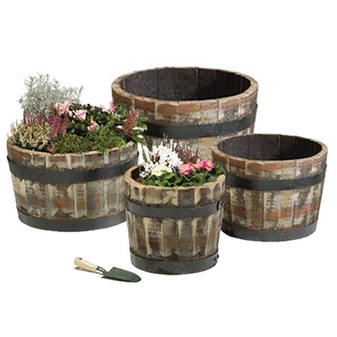 wooden whiskey barrel planters 16 quot real wooden whiskey barrel planter garden plants rustic oak tub hogie 4002 ebay