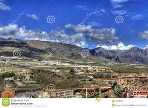 Buildings on the scenic mountainside of Tenerife, Canary Islands. Abstract