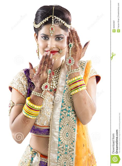 beautiful indian bride with mehendi hands or henna stock