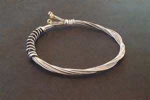 How To Make Jewelry Out Of Guitar Strings - a handmade recycled guitar string bracelet bangle bound with