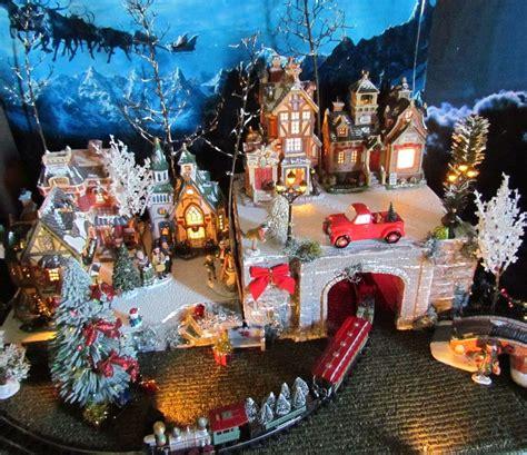 christmas lighted train tunnel village display platform