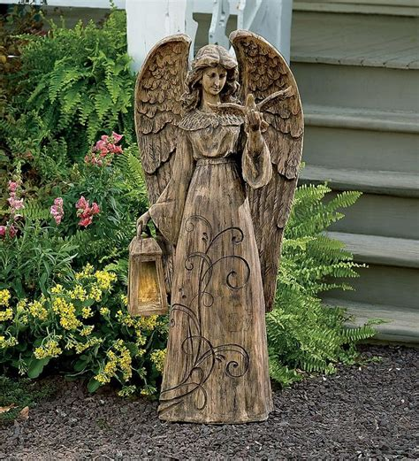 angel statue with solar light resin garden angel with solar lighted lantern is peaceful