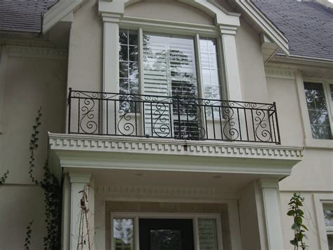 wrought iron balcony railings designs with wall brick