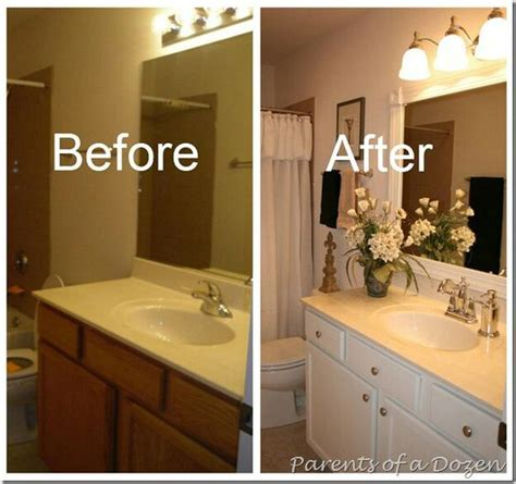 how to update a bathroom builder grade cabinets and how to paint on pinterest