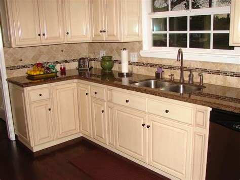 white kitchen cabinets granite countertops antique white raised panel cabinets and tropical brown