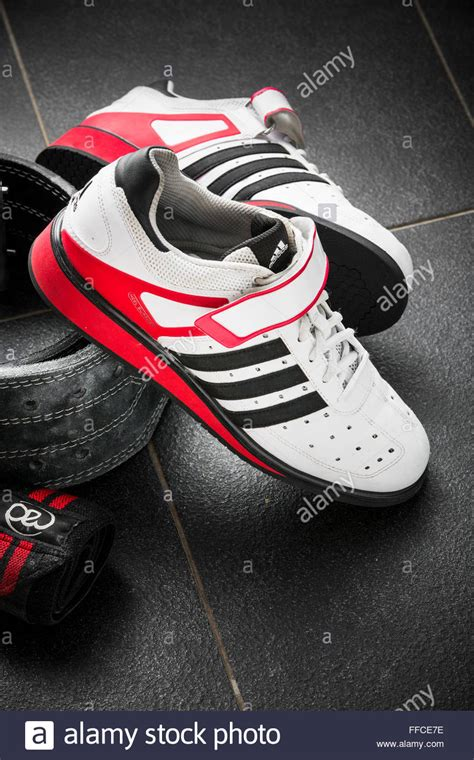 olympic weightlifting shoes adidas olympic weightlifting shoes on a grey tiled floor