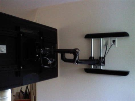 swinging wall mount for tv audio impact installation of the week floating tv audio