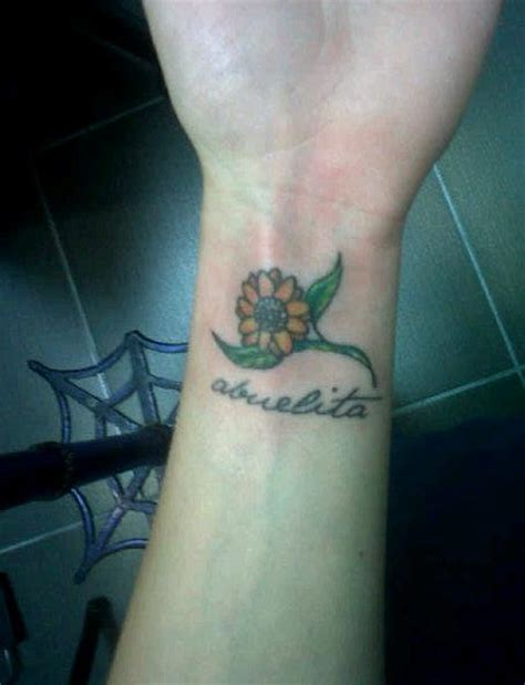 small sunflower tattoo on wrist small flower tattoos designs ideas and meaning tattoos