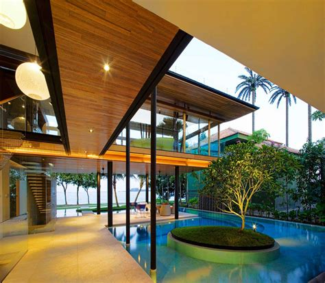 seafront home in singapore with underwater media room glass walls terrace pool stunning beachfront home with