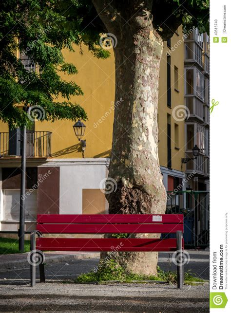 red park bench red park bench in urban setting stock photo image 49616740