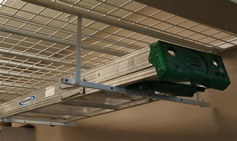 Ladder Storage Racks For Garage by Ladder Hanger Front The Garage Organization Company