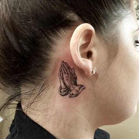 tattoo behind ear dangerous hands praying hands and tattoos and body art on pinterest