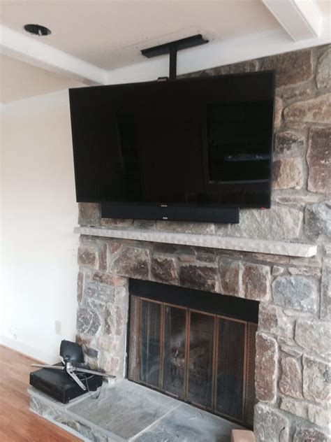 tv mounted on fireplace ceiling mounted tv fireplace yelp