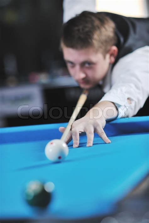 pro billiard player finding best solution and right angle at billard or snooker pool sport