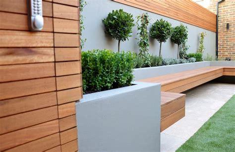garden wall bench bespoke storgae in hardwood slats raised beds render block walls bench in hardwood