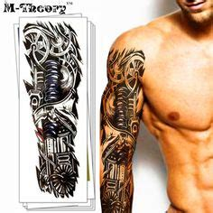 steampunk machine arm tattoo