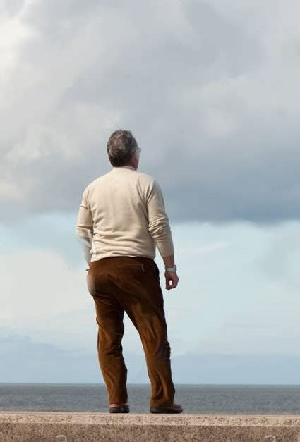 standing in another mans 1409109402 rear view of a man standing on sea wall another man