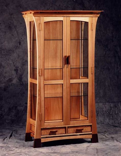 Curio Cabinet: A tall and skinny cabinet with glass doors