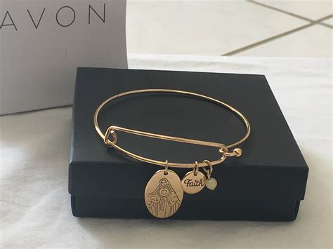 precious charms bracelet by avon in gold tone
