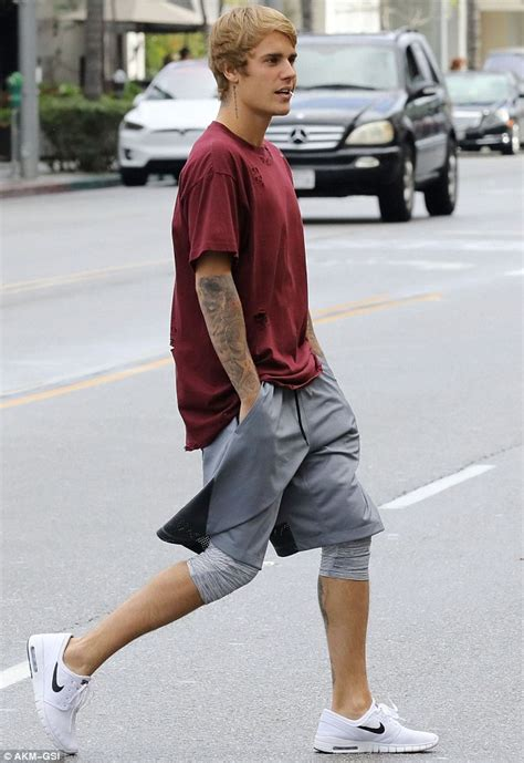 justin bieber showcases his classic haircut as he goes for