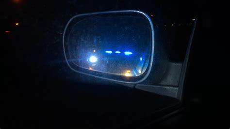 cop lights in mirror lights stock footage
