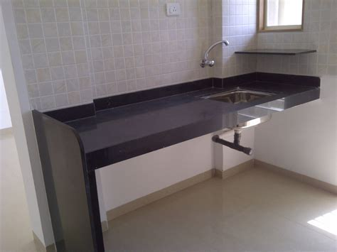 Granite Kitchen Platform with Stainless Steel Sink in the
