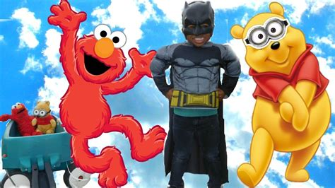 Disney Elmo Available batman takes elmo and disney winnie the pooh dressed as a minion to the playground for