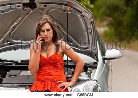 woman driver on the phone for car breakdown roadside breakdown woman driver using mobile phone for