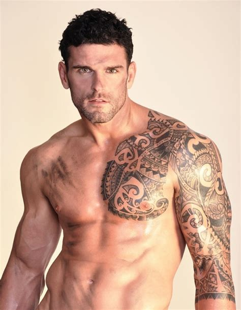 muscular man with right sleeve tattoos real photo