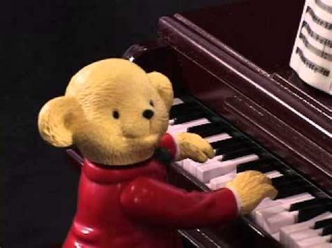 mr christmas teddy takes requests with baby grand piano