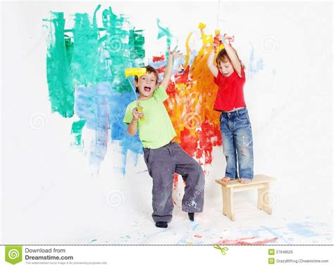 Small European House Plans happy children painting wall with colours royalty free