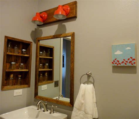 barn light bathroom wall sconce lighting brings pop of color to bathroom